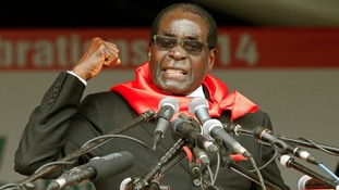 Zimbabwe President Robert Mugabe addresses his supporters.
