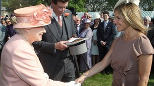 Katie Couric meets the Queen at a Garden Party at Buckingham Palace on Tuesday