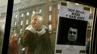 'Wanted' pictures featuring Yanukovich's face adorn cars.