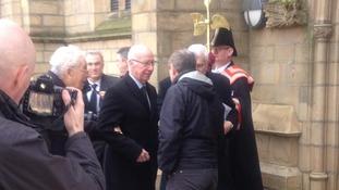 Former England and Manchester United star Sir Bobby Charlton, centre, arrives at Preston Minister