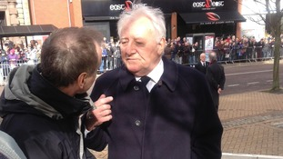 Former Manchester United boss Tommy Docherty outside as crowds await the arrival of Sir Tom Finney's cortege