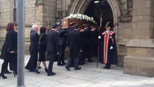 Sir Tom Finney's coffin is carried into Preston Minster