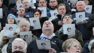 Fans sing along during the service which was broadcast live to fans at Deepdale