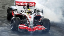 Lewis Hamilton performs a donut in his F1 car
