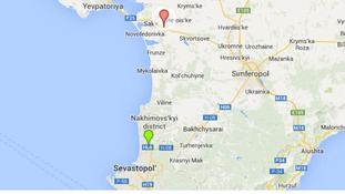 The helicopters were seen travelling south from Saky, red marker, towards Sevastopol's military Belbek airport in the south.