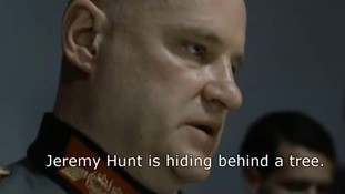 "A still from the YouTube clip shows one of Hitler's aides in the film saying ""Jeremy Hunt is hiding behind a tree"""