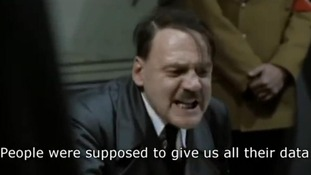 Another still shows the character playing Hitler criticising the care.data system