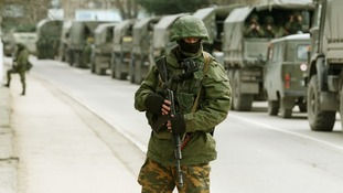 Armed servicemen wait in Russian army vehicles outside a Ukranian border guard post in the Crimean town of Balaclava.