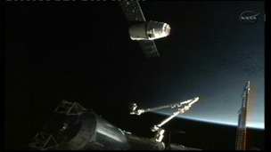 The SpaceX Dragon commercial cargo spacecraft docks at the International Space Station