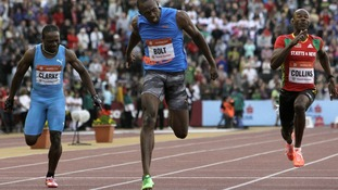 Usain Bolt crosses the finish line in the 100 meters men's race at the IAAF World Challenge