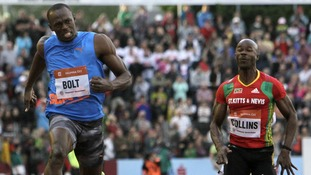Usain Bolt approaches the finish line