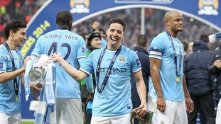 Manchester City's Samir Nasri celebrates with the Capital One Cup trophy after victory over Sunderland