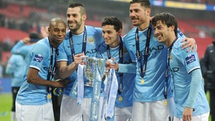 Manchester City's Luis Fernandinho, Alvaro Negredo, Gonzales Jesus Navas, Francisco Javi Garcia and David Silva (left to right) celebrate with the Capital One Cup trophy after victory over Sunderland