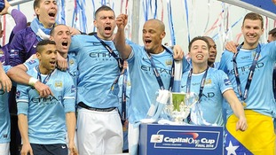 Manchester City players celebrate victory in the Capital One Cup final.