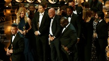 Producer Brad Pitt takes to the stage with the rest of the Oscar-winning Best Picture cast and crew.