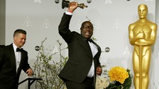 Steve McQueen celebrates 12 Years a Slave's win at the Oscars with producer Brad Pitt.