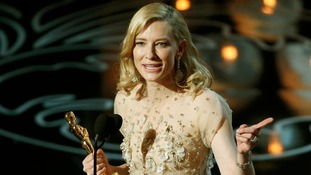 Cate Blanchett picks up the Best Actress Oscar for Blue Jasmine.