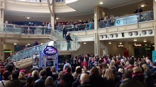 Hundreds of shoppers tried to get a glimpse of the action.