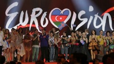  Winning contestants celebrate on stage after the first semi-final of the Eurovision song contest in Baku