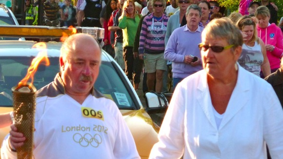 Blind man carrying torch