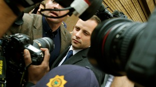 Oscar Pistorius pictured leaving the court in Pretoria, South Africa, yesterday.