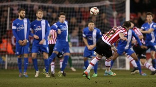 Ben Davies fires in the opening goal.