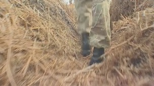 A soldier walks through the trenches in the heathland of Gosport, Hampshire.