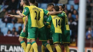 Wes Hoolahan is embraced by his teammates after scoring against Aston Villa.