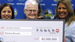 Emma Duvoll holds her winning Powerball cheque