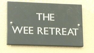 The building is called 'The Wee Retreat'.