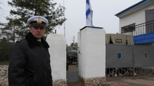 Ukrainian and Russian soldiers in stand-off at military base