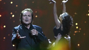 "Engelbert Humperdinck performs his song ""Love Will Set You Free"". He's representing the UK"