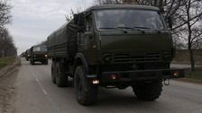 Crimea: Ukraine defiant as unmarked trucks roll in