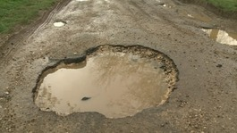 Pothole victim calls for action