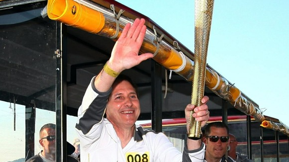 Olympic torch on train