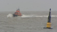Man dies and two missing as boat capsizes off Suffolk
