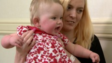 Paralysed mum recovers to hold her baby for first time