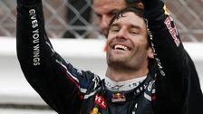 Red Bull driver Mark Webber, of Australia, celebrates after winning the Monaco Formula One Grand Prix at the Monaco racetrack, in Monaco