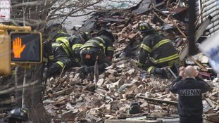 New York City Firefighters dig through the rubble