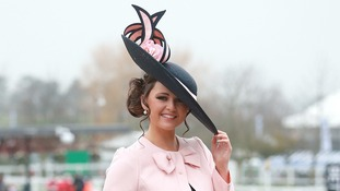 Jennifer Wrynne from Ireland holds onto her hat at the Cheltenham Festival.
