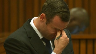 Oscar Pistorius reacts in the dock during court proceedings at the North Gauteng High Court in Pretoria.
