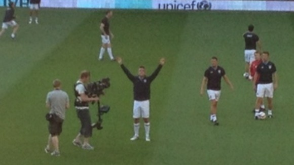 Robbie Williams salutes the fans as Soccer Aid gets underway at Old Trafford