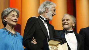 Dirctor Michael Haneke (centre) presented with the Palme d'Or award for his film 'Love'