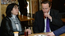 Prime Minister David Cameron takes a drink with the Mayor of Bethlehem Vera Baboun.