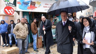 Prime Minister David Cameron is shown around Bethlehem by Mayor Vera Baboun.