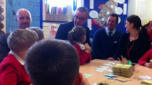 Michael Gove is shown some of the pupils' work