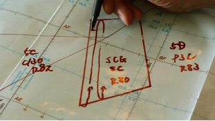 A Japan Coast Guard explains their search plan in an area of operation.
