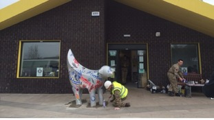 An Engineer Regiment soldier cements a 'Superlambanana' in place