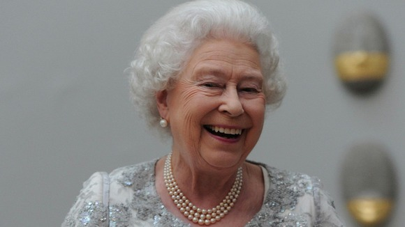 Queen Elizabeth II laughs as she attends a Diamond Jubilee celebration of the arts at the Royal Academy of Arts in central London.