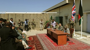 Brigadier James Woodham and the Provincial Governor of Lashkar Gah holding at the handover of Main Operating Base Lashkar Gah.